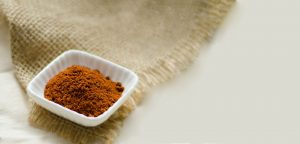 Curry Powder in a small square bowl. Used for seasoning
